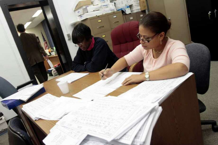 Workers count ballots at McLevy Hall in Bridgeport, Conn. in the early hours of Wednesday, Nov. 3rd. Photo: Chris Preovolos / Stamford Advocate