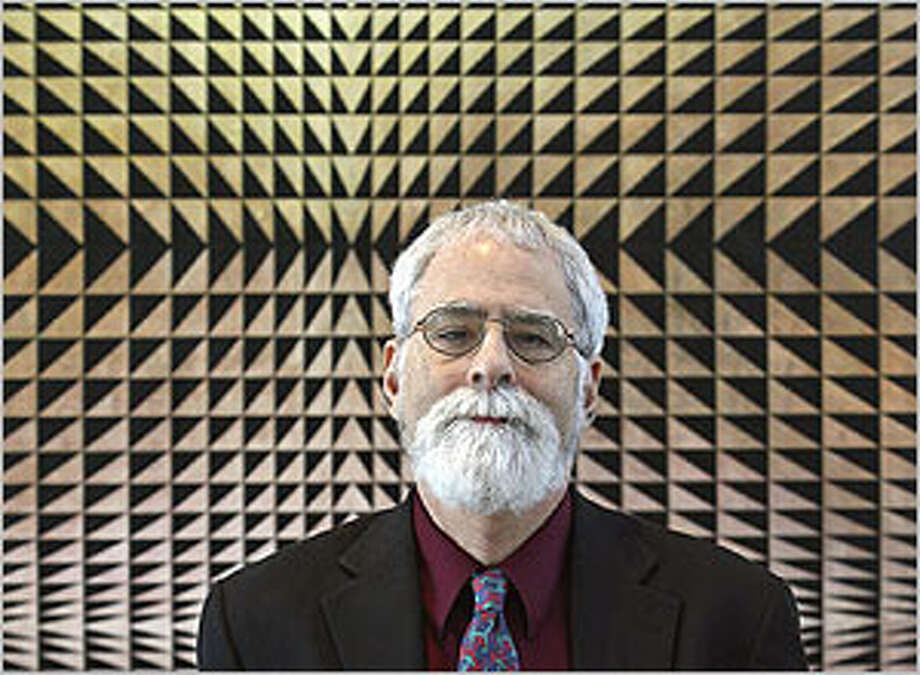 "David Rubin, curator of ""Psychedelic,"" stands in front of ""Trinity"" by Philip Taaffe."
