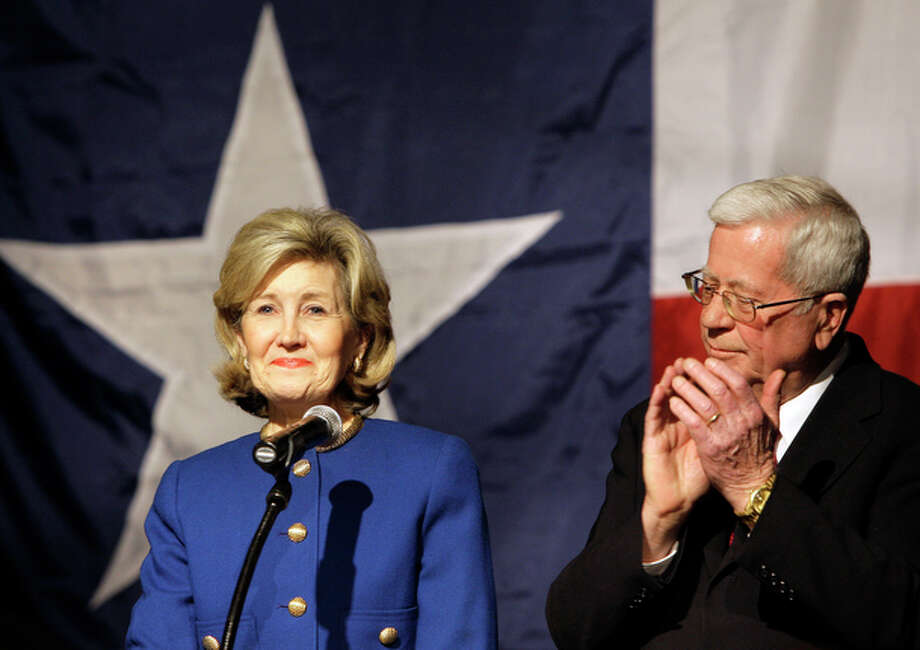 Sen. Kay Bailey Hutchison, R-Texas, left, smiles as she acknowledges support from her husband Ray, right, and others following her speech conceding from the Republican nomination for Texas governor in Dallas on Tuesday, March 2, 2010. / AP