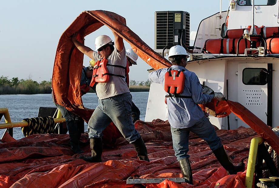Workers load oil booms onto a crew boat to assist in the containment of oil from a leaking pipeline in the Gulf of Mexico near the coast of Louisiana, Thursday, April 29, 2010. The government has sent skimmers, booms and other resources to clean up a massive oil spill in the Gulf of Mexico that's become far worse than initially thought and threatens the fragile marshlands along the shore, a Coast Guard official said Thursday. / FR158704 AP