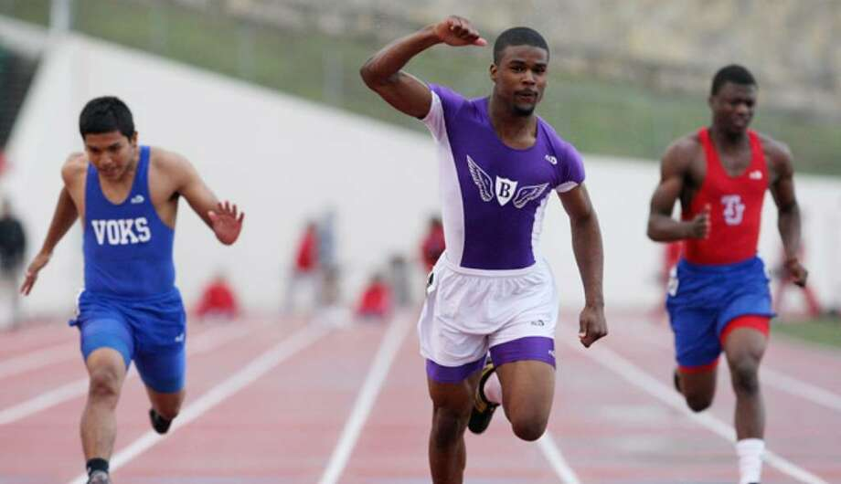 Brackenridge's Willie Culpepper (center) reacts to his victory in the 100 meters at the 28-4A track meet at Alamo Stadium.