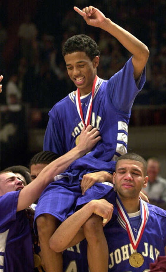 Chris Ross is carried on the shoulders of his Jay teammates upon being named the tournament MVP after their state-title victory over Dallas Kimball on March 9, 2002.