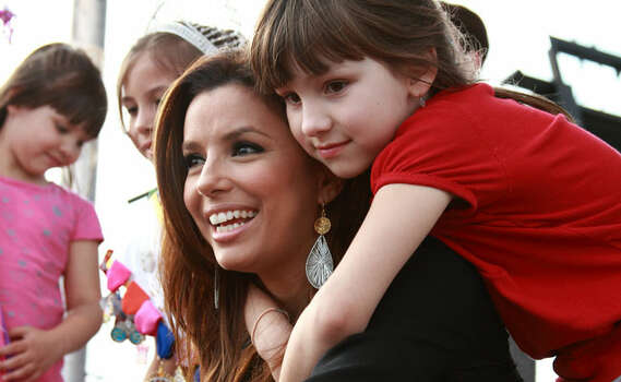 "Eva Longoria Parker, television star on ABC's ""Desperate Housewives"" and wife of San Antonio Spur Tony Parker, helped headline the opening of Morgan's Wonderland Saturday."