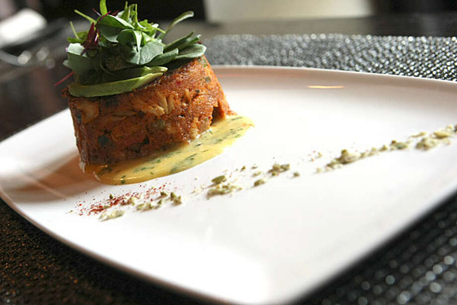 Citrus Crab Cake is held together with panko and spiced with chili powder and roasted jalape?os.