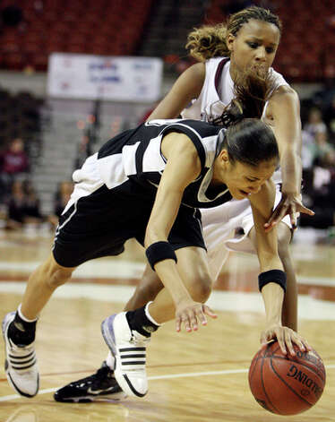 Steele's Meighan Simmons grabs for a loose ball against Timberview's Maegan Conwright. / eaornelas@express-news.net