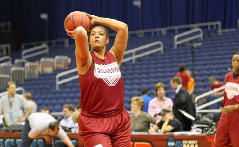 Oklahoma's Lyndsey Cloman, a Taft graduate, shoots while going through drills during Saturday's open practice at the Alamodome. She has played in 21 games for the Sooners as a freshman, averaging just less than nine minutes per game.