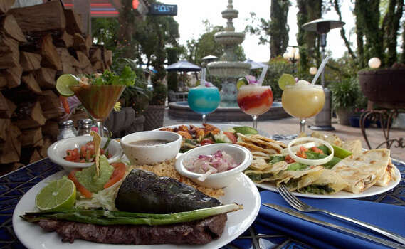 Lush foliage and fountains bring an exotic, tropical feel to La Fogata, which is inside loop 410. Enjoy margaritas and the strolling mariachis. http://www.lafogata.com