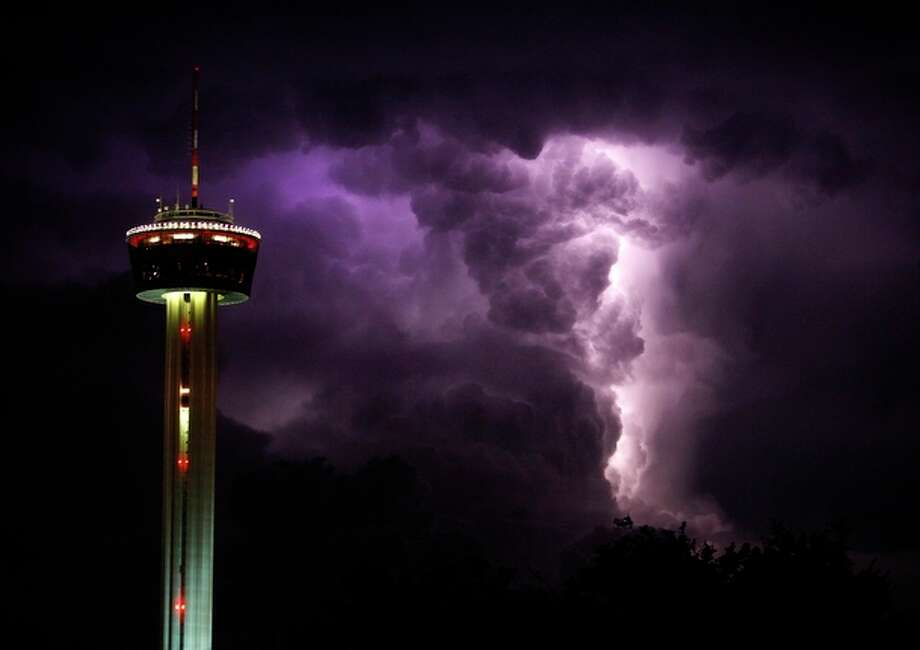 Lightning makes for a spectacular sky near the Tower of the Americas Friday night, Aug. 21, 2009. / lkrantz@express-news.net
