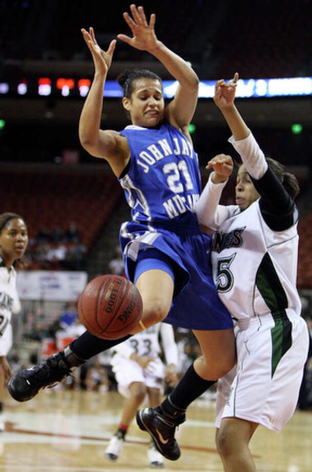 Jay's Erica Donovan loose control of the ball as she is defended by Fort Bend Hightower's Azalea Hall in the 2010 UIL girls basketball 5A state semifinal game at the Erwin Center Friday March 5, 2010 in Austin, TX. Fort Bend Hightower won 52-49. / eaornelas@express-news.net
