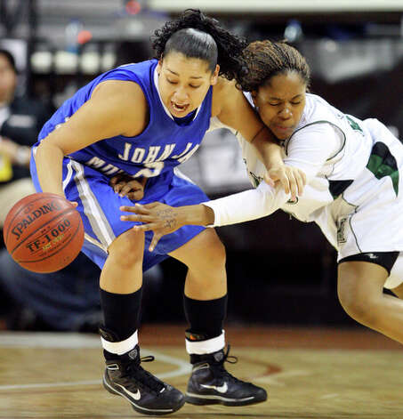Jay's Destiny Amezquita and Fort Bend Hightower's Jasmine Brewer grab for a loose ball. / eaornelas@express-news.net