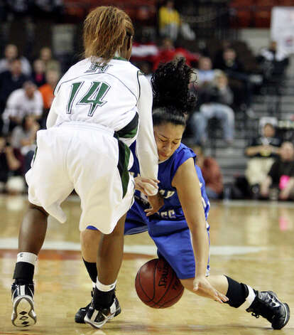 Jay's Destiny Amezquita and Fort Bend Hightower's Brittney Matthew grab for a loose ball. / eaornelas@express-news.net