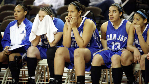 Members of the John Jay Mustangs watch action from the bench. / eaornelas@express-news.net