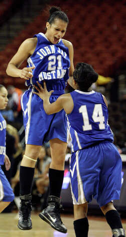 Jay's Erica Donovan celebrates with teammate Kiara Taylor after making a three pointer. / eaornelas@express-news.net