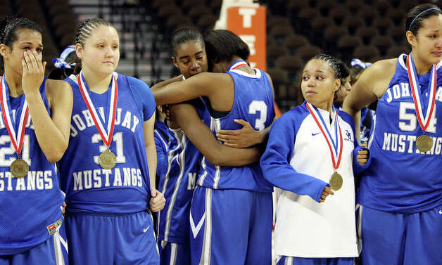 Members of the John Jay Mustangs react after the game. / eaornelas@express-news.net
