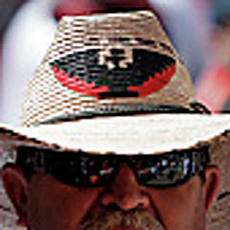 A participant wears a hat with the thunderbird symbol at the 14th annual Cesar E. Chavez March for Justice on Saturday, Mar. 27, 2010. The march started at Guadalupe Plaza and progressed toward Alamo Plaza. Mayor Julian Castro along with other city officials joined in the march to honor the anniversary of the civil rights activist and labor leader's efforts to bring attention to the issues of workers' rights. Kin Man Hui/kmhui@express-news.net / kmhui@express-news.net