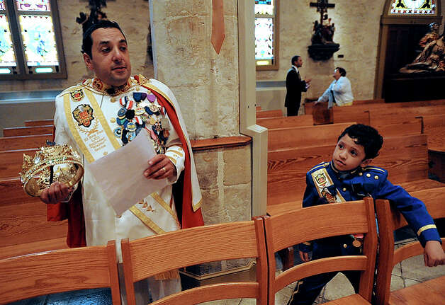 "Serna prepares for his  coronation at San Fernando Cathedral. ""I never really envisioned myself being in the parade as king,"" said Serna, who grew up attending Fiesta events. But he decided to put to use all the contacts he'd built up over the years working as an attorney. This year, Serna raised $200,000 for scholarships. / gcalzada@express-news.net"