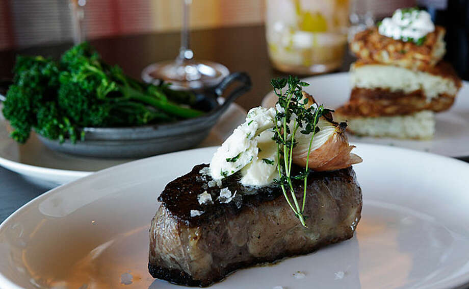 The 12-ounce New York Strip is topped with herbed butter, roasted onion and fresh thyme.