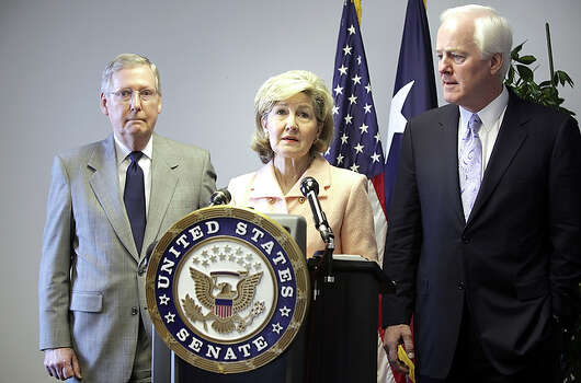 U.S. Sen. Kay Bailey Hutchison ended months of speculation about her political future by announcing that she will remain in the Senate for the remainder of her term.With her during the announcement are U.S. Senate Republican Leader Mitch McConnell of Kentucky (left) and U.S. Senator John Cornyn of Texas. / rowen@express-news.net