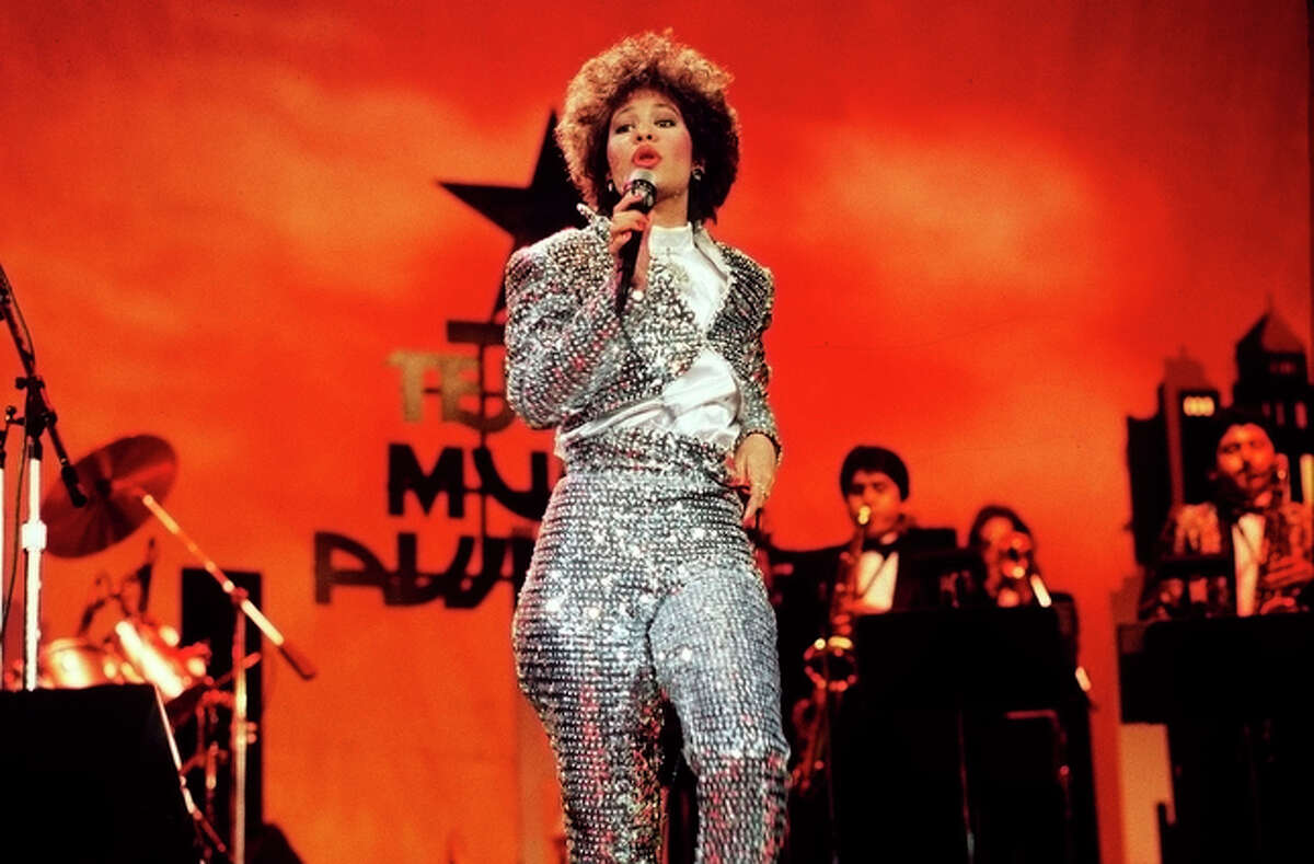Selena Quintanilla, female vocalist of the Year for 1987, singing on stage during the Seventh Annual Tejano Music Awards on March 23, 1987.