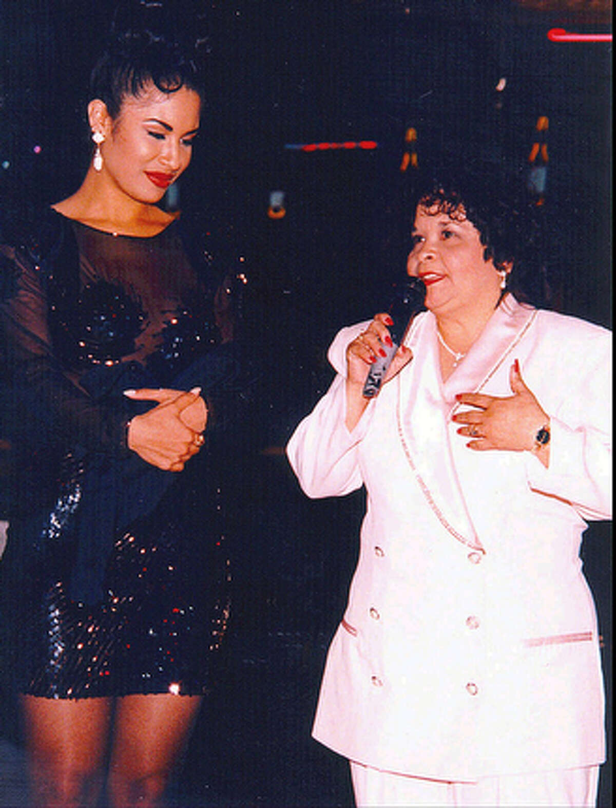 Tejano star Selena, left, watches as Yolanda Saldivar speaks to a crowd at a post-1994 Tejano Music Awards party in San Antonio, Texas.