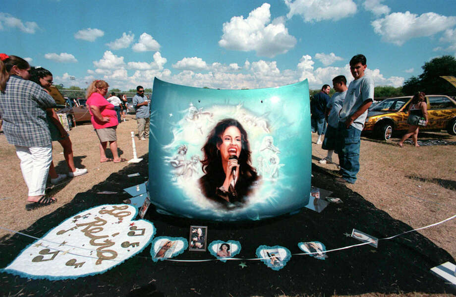 "Spectators at the Low and Slow Classic Car Show checkout the art work on the ""Selena"" car Sunday Oct. 3, 1999 in San Antonio."
