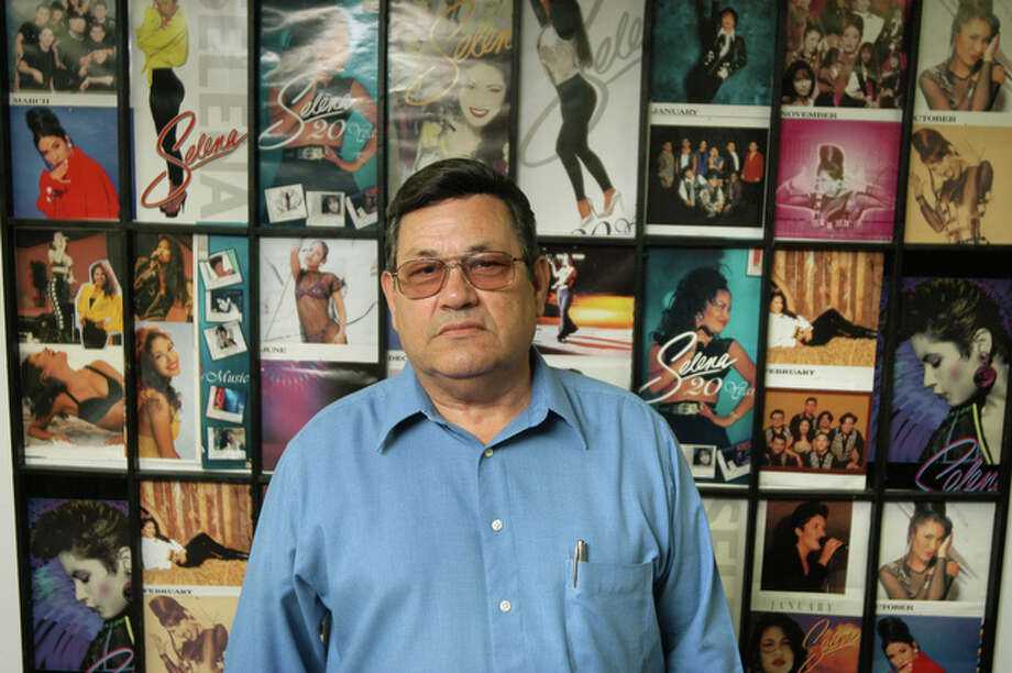 "Abraham Quintanilla, father of deceased Tejano singer Selena, stands in front of a wall displaying photos of his daughter at ""Q"" Productions in Corpus Christi, Texas, Thursday, March 17, 2005. Quintanilla said Tejano music is a product of Mexican-American kids that are born and raised here in Texas that are exposed to all different genres. / AP2005"
