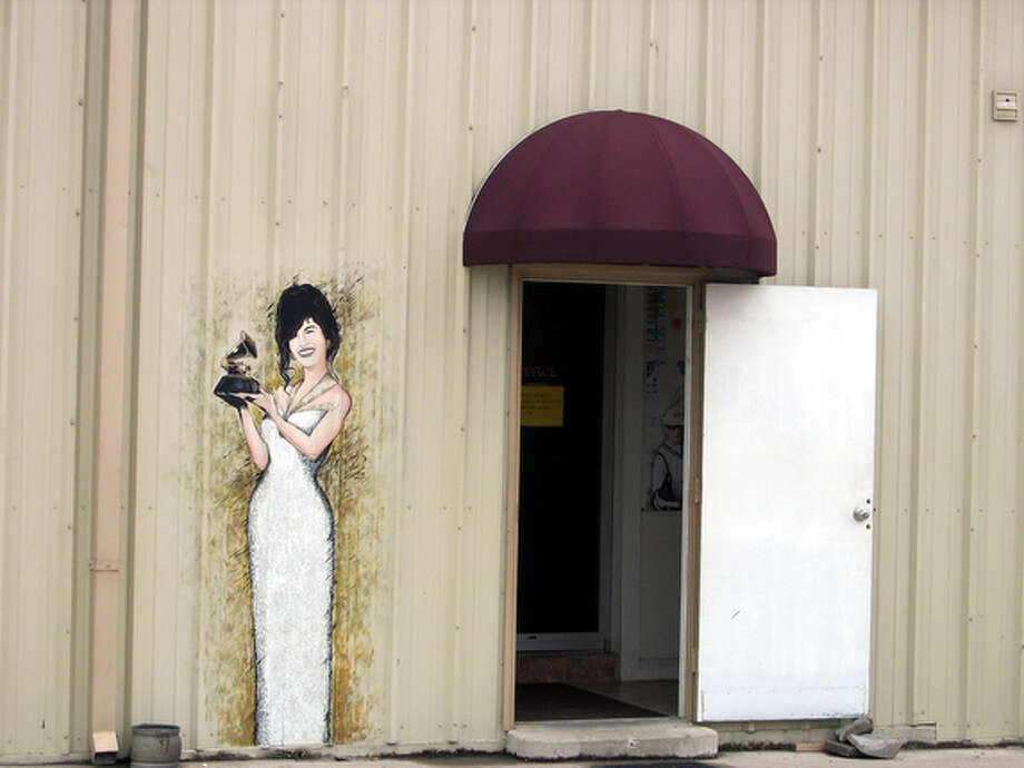 Low-key entrance to the Selena Museum on Leopard Street in Corpus Christi is marked by little more than a likeness of the singer. / SAN ANTONIO EXPRESS-NEWS