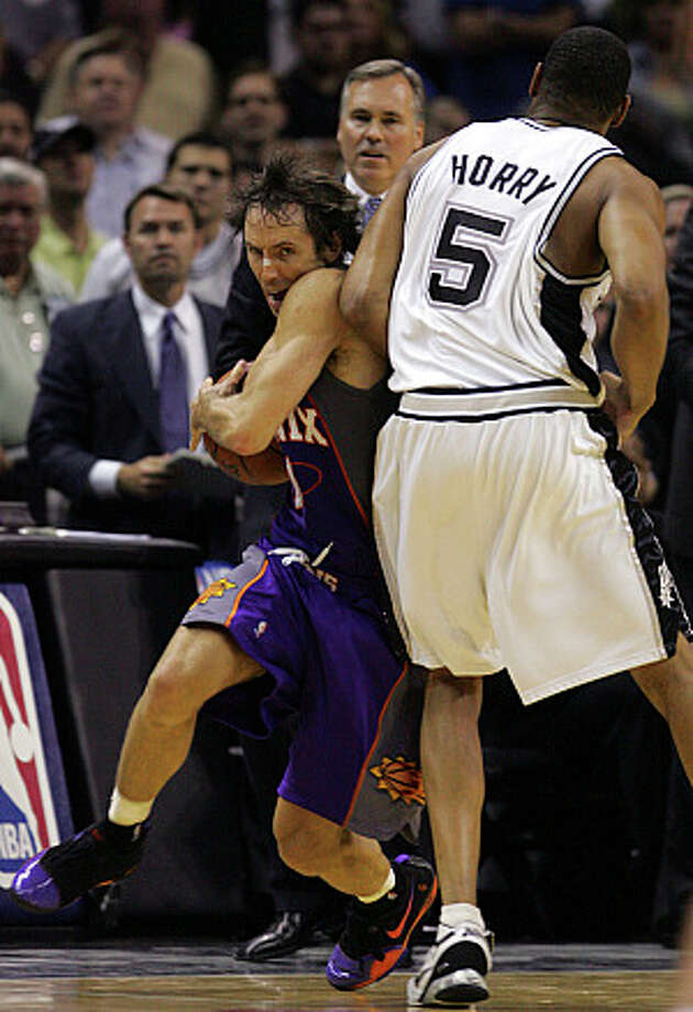 The Spurs' Robert Horry collides with the Suns' Steve Nash in Game 4 of the 2007 Western Conference semifinals.