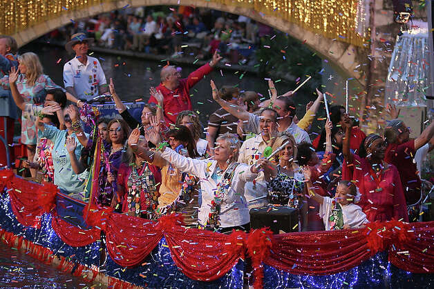District Attorney Susan Reed acknowledges River parade goers as her float enters the Arneson Theater.