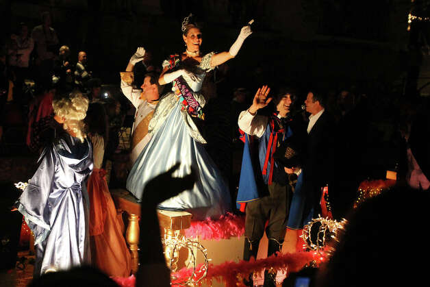 Cinderella waves at the crowd from the Brighton Center float. / spoecial to the San Antonio Express-News