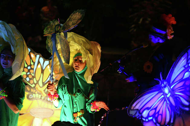 Children wave from The Battle of Flowers Association Butterfly Garden float. / spoecial to the San Antonio Express-News