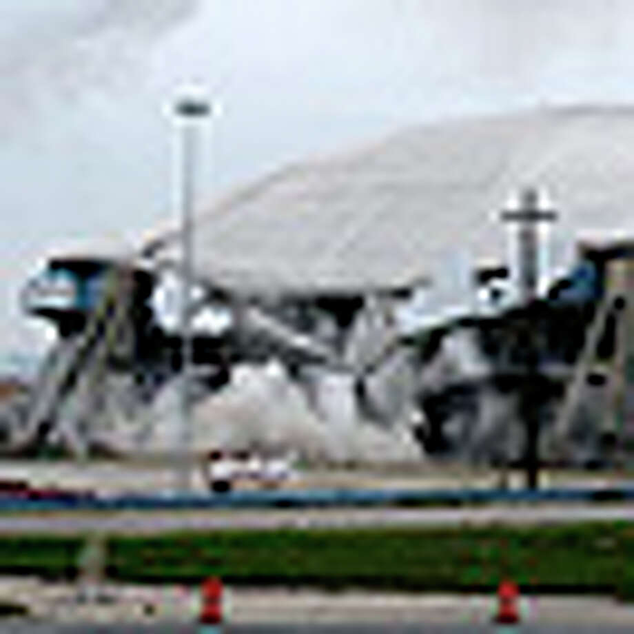 METRO   -- Texas Stadium, home of the Dallas Cowboys between 1971 and 2008 is imploded, Sunday, April 11, 2010. The stadium cost $35 million to build. The Cowboys moved to Cowboy Stadium in Arlington. Cowboy Stadium cost $1.5 billion. JERRY LARA/glara@express-news.net / glara@express-news.net