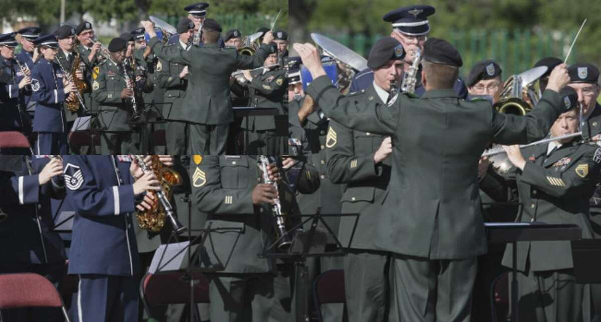 A combined Army-Air Force band plays during a ceremony in which the Army garrison at Fort Sam becomes the 502nd Mission Support Group/Garrison. Its parent, the 502nd Air Base Wing, also oversees logistics at Randolph and Lackland AFBs.