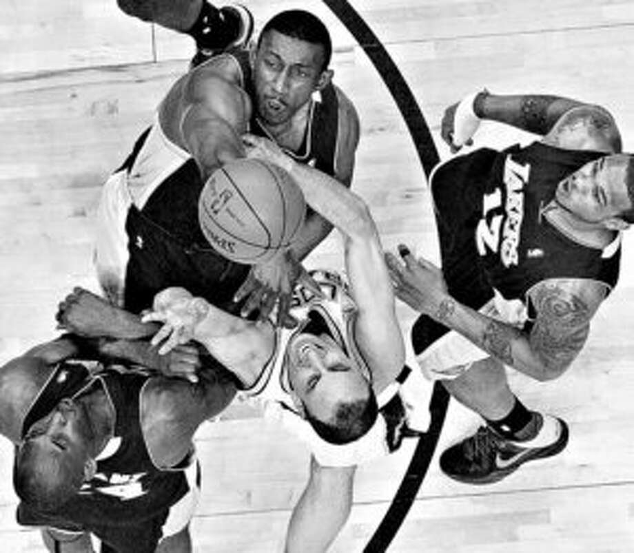 Manu Ginobili, who has been starting since Tony Parker broke his hand, drives into a pack of Lakers defenders.