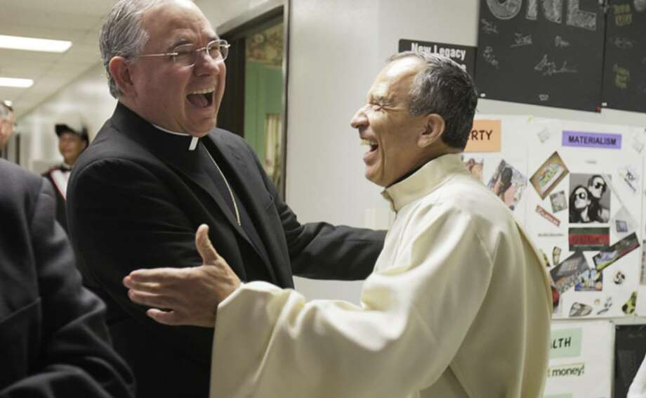 Archbishop Jose Gomez shares a laugh with Father David Garcia before a farewell Mass for Gomez at St. Mark the Evangelist Catholic Church. Gomez is expected to replace Cardinal Roger Mahony as Los Angeles' archbishop in February, when he retires.