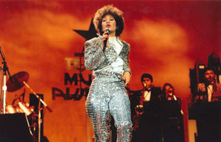 Selena, female vocalist of the year, sings at the 1987 Tejano Music Awards.