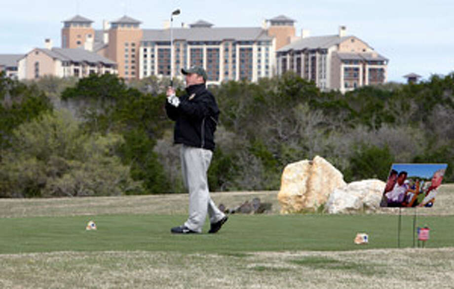 Army veteran Philip Hall tees off on the par-3 No. 3 hole at the AT&T Oaks course during Saturday's charity tournament.