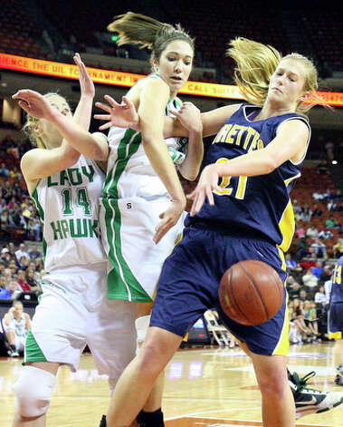 Wall's Sally Higgins (from left) and Karli Kellermeier grab for a rebound against Poth's Tara Dunn during first half action of their 2010 UIL girls basketball 2A state semifinal game at the Erwin Center Friday March 5, 2010 in Austin, TX. Wall won 56-32. / eaornelas@express-news.net