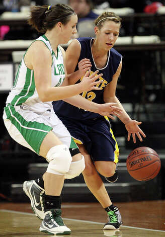 Poth's Erica Moczygemba looks for room around Wall's Shannon Carrico. / eaornelas@express-news.net