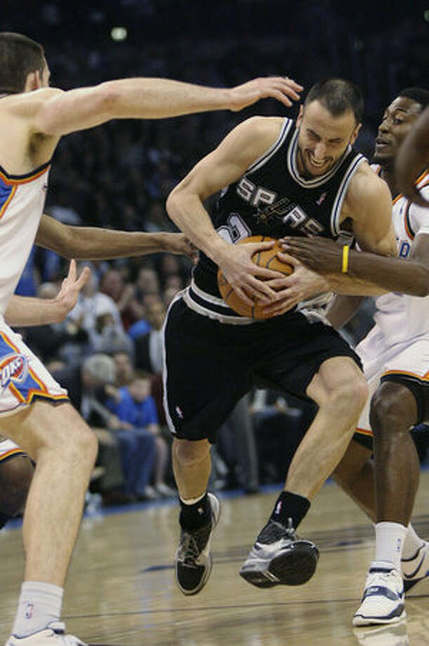 Spurs guard Manu Ginobili (center) drives to the basket between Oklahoma City's Nick Collison (left) and Kyle Weaver. Ginobili had 21 points as the Spurs won the season series against the Thunder 3-1.
