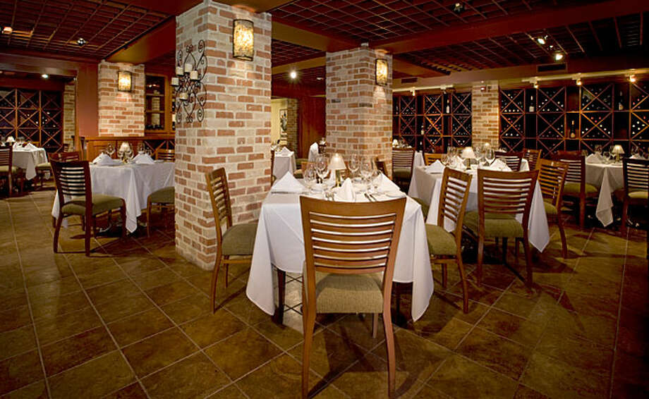 The wine cellar at Ruth's Chris at Sunset Station was recently renovated and included new tile. / 2009 Mark Humphries