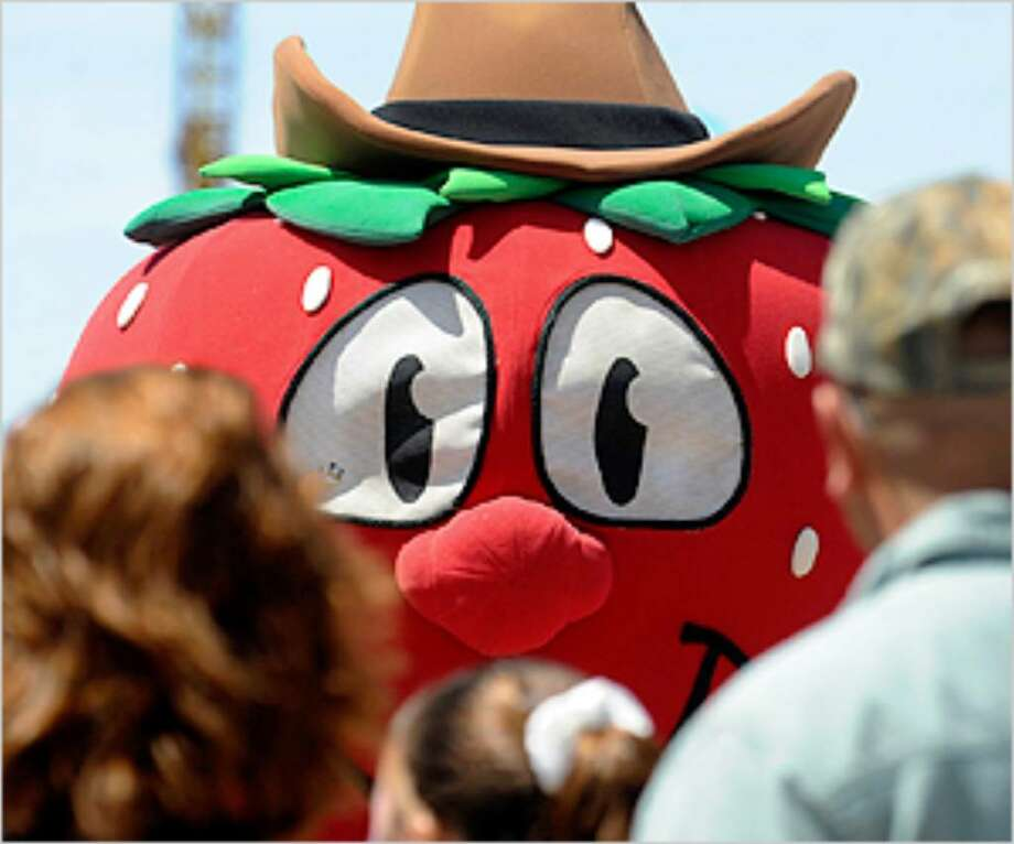 The Poteet Strawberry Festival mascot greets visitors to last year's event.