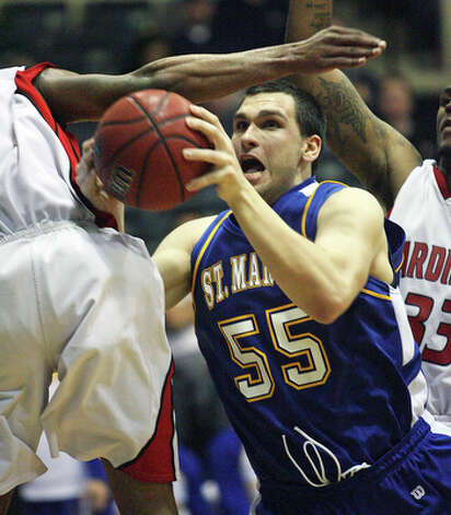 The Rattlers' Kevin Kotzur draws a foul in the lane. / © 2010 San Antonio Express-News