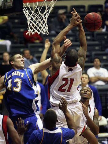 Brad Hubenak blocks a shot for St. Mary's. / © 2010 San Antonio Express-News