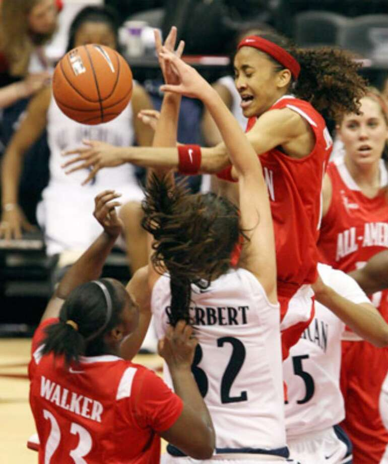 Steele High School's Meighan Simmons (top right) battles for control of the ball en route to a 21-point effort in the WBCA High School All-America Game at the Alamodome.