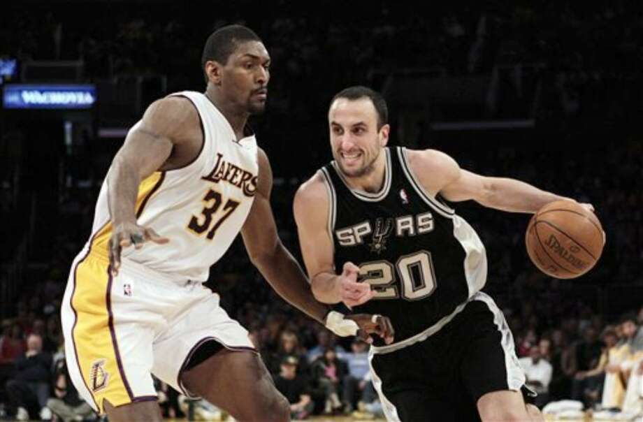 Spurs guard Manu Ginobili (right) drives past the Lakers' Ron Artest.