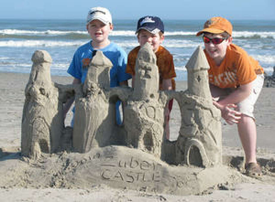 The Zuber brothers of San Antonio ? Jack, 10 (from left); A.J., 6; and Ben, 12 ? show off the sand castle they built  at Port Aransas.