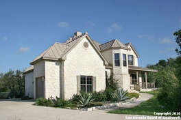 This two-story house sits on 5 acres in the Ranchland Oaks subdivision in Mico. It was designed to take advantage of the views.