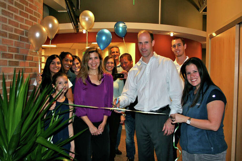 Todd Wilkowski (center), co-owner of Performance Physical Therapy and Integrated Health, is joined by his staff at the opening of the Performance's new offices in Westport. Photo: Contributed Photo / Westport News