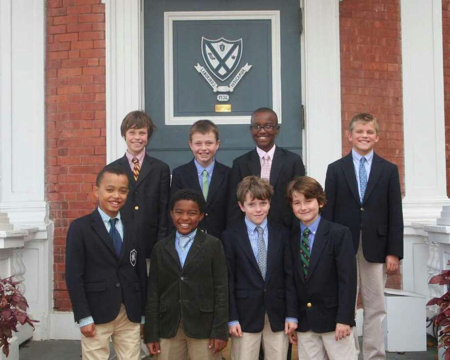 Fairfield Country Day School recently sent a group of 5th-graders to represent their cchool andperform in the State Children's Honor Choir Festival. Pictured are (rear) Clay Wackerman, Charlie Millard, Laz Brown, Billy Duffy and (front) Robinson Brown, Shaka Moales, Charlie Pearce and Alexander McMullen. Photo: Contributed Photo / Fairfield Citizen contributed